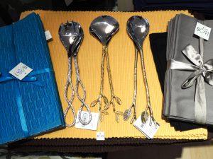 Stainless Steel serving spoons $45, and a large selection of table settings.